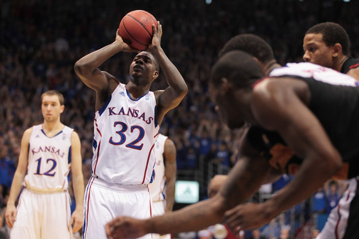 LAWRENCE KS - DECEMBER 18:  Josh Selby #32 of the Kansas Jayhawks shoots a free throw during the game against the USC Trojans on December 18 2010 at Allen Fieldhouse in Lawrence Kansas.  (Photo by Jamie Squire/Getty Images)