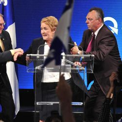 Parti Quebecois Leader Pauline Marois is whisked off stage as she delivered her victory speech in Quebec, Tuesday Sept. 4, 2012. With the win, Marois becomes the first female premier in Quebec history. Police were not immediately able to provide details but party organizers informed the crowd that there had been an explosive noise and they needed to clear the auditorium. Police say one man was arrested and two people were injured.