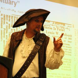 """""""Captain Jack"""" talks about obituaries at a RootsTech media dinner at the Salt Palace Convention Center on Wednesday. FamilySearch is using a pirate theme of """"Dead men tell no tales ... but their obituaries do"""" to garner support for creating a searchable online database for obituaries."""