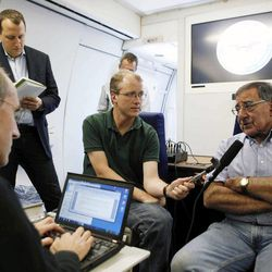 U.S. Secretary of Defense Leon Panetta, right, speaks to the media aboard his aircraft on way to an official visit to Japan, China and New Zealand, Saturday, Sept. 15, 2012.