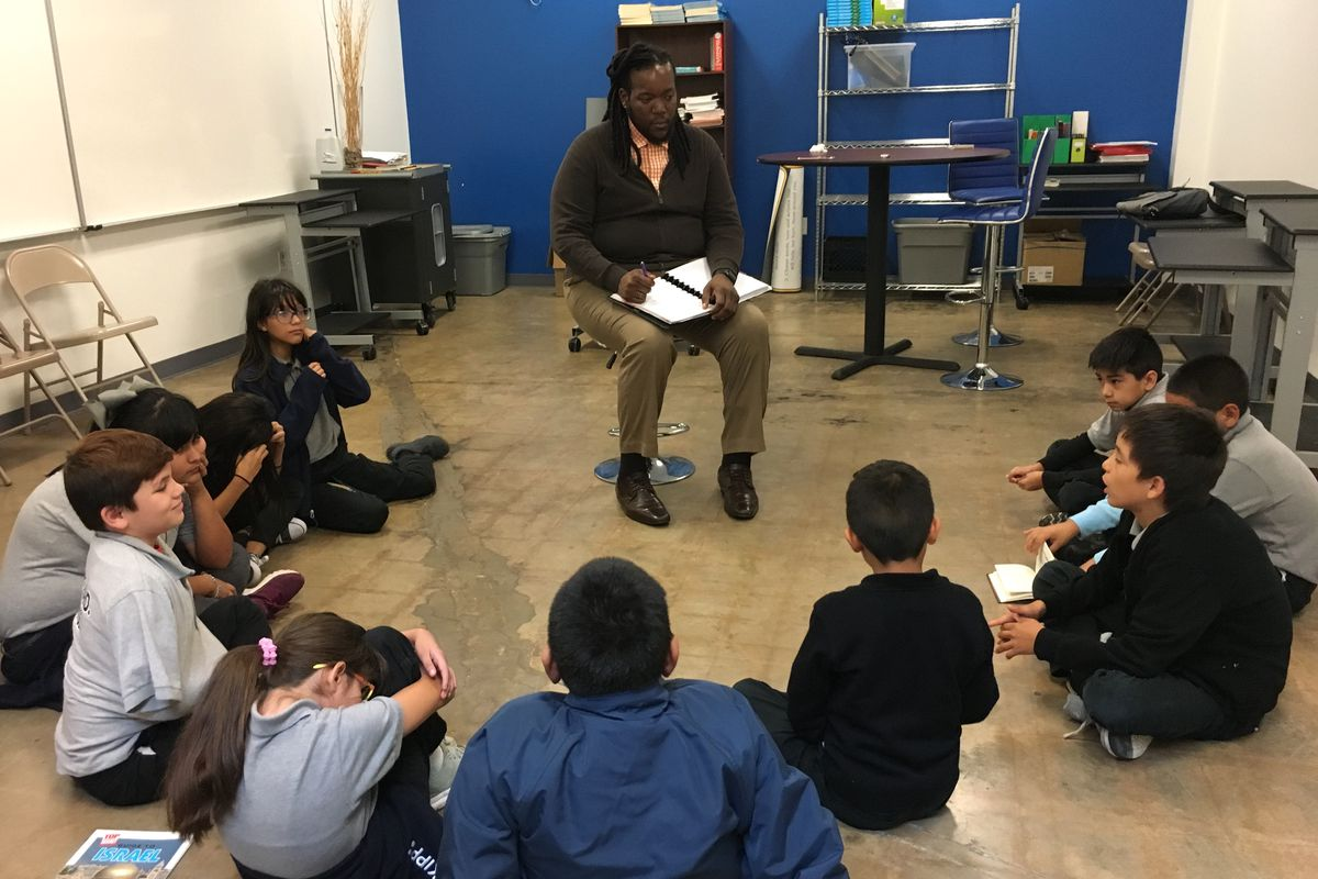 KIPP Camino's Dean of Culture Curtis Bailey conducts a circle with ten fifth-grade students on a recent afternoon at a San Antonio campus.