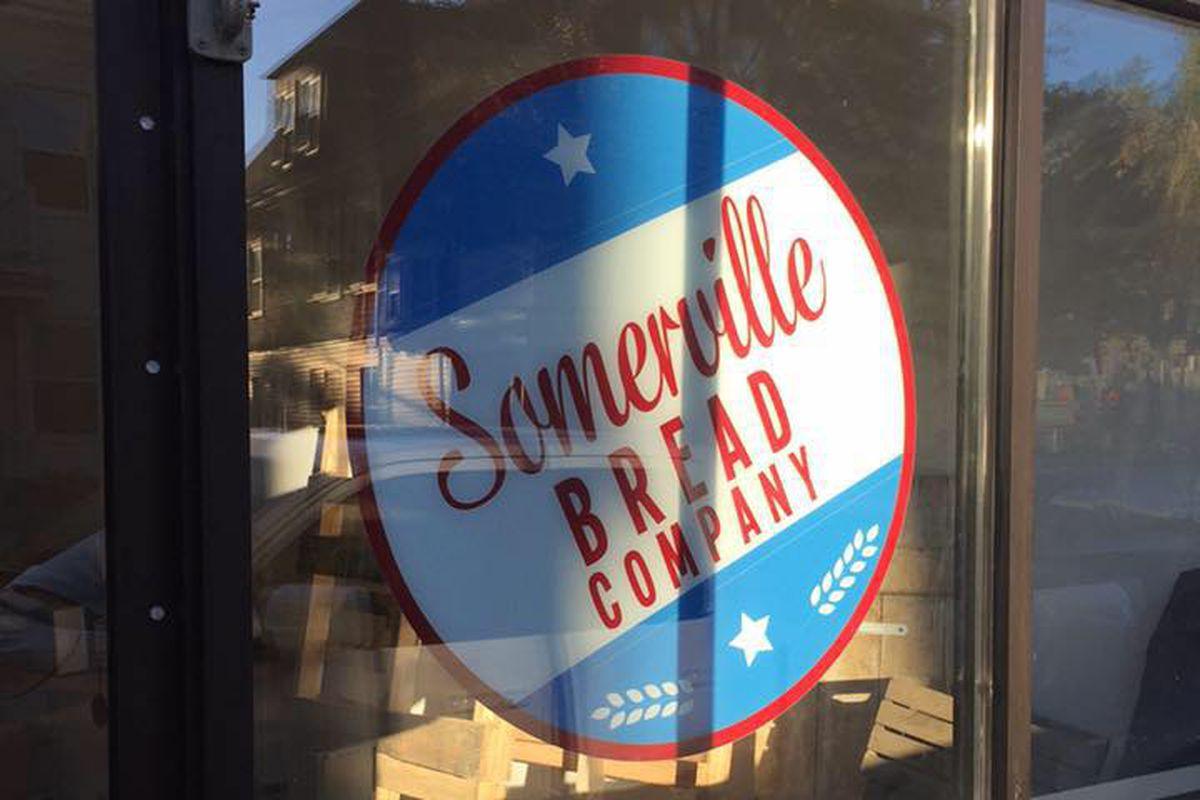 Somerville Bread Company's logo in the window