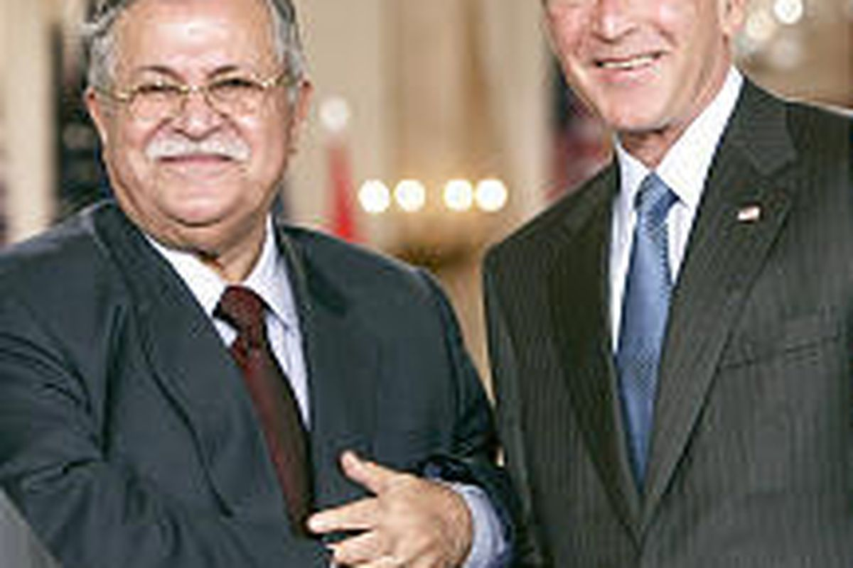 Iraqi President Jalal Talabani and President Bush shake hands Tuesday in the East Room of the White House.