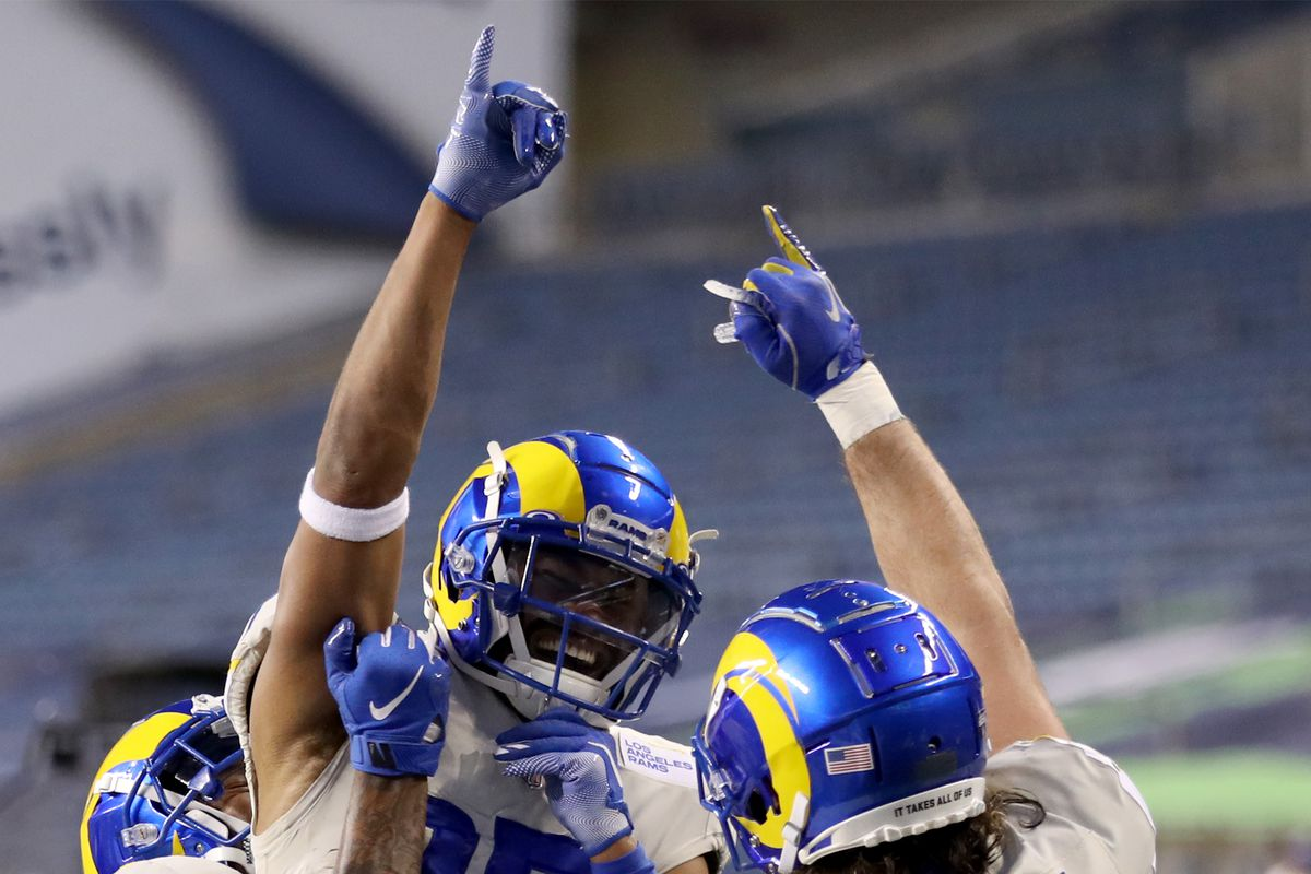 Wide receiver Robert Woods #17 of the Los Angeles Rams celebrates with teammates after rushing for a touchdown during the fourth quarter of the NFC Wild Card Playoff game against the Seattle Seahawks at Lumen Field on January 09, 2021 in Seattle, Washington.