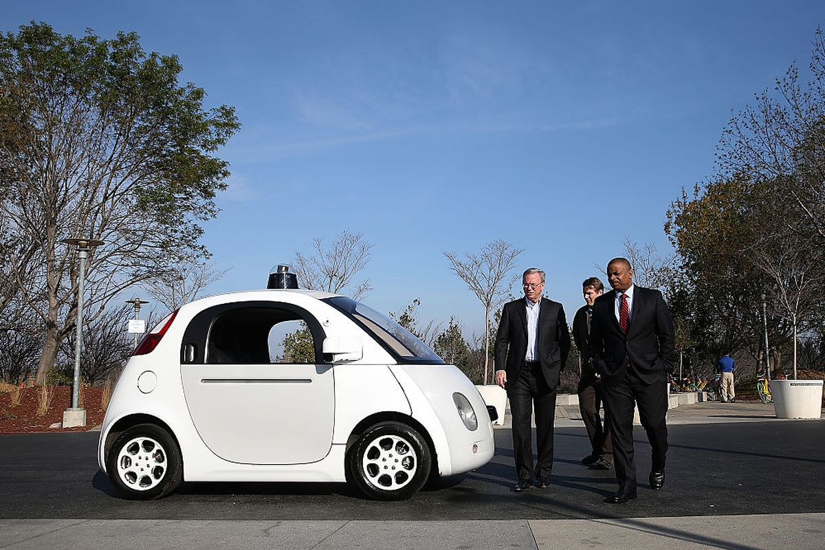 MOUNTAIN VIEW, CA - FEBRUARY 02: U.S. Transportation Secretary Anthony Foxx (R) and Google Chairman Eric Schmidt (L) walk around a Google self-driving car at the Google headquarters on February 2, 2015 in Mountain View, California. U.S. Transportation Sec