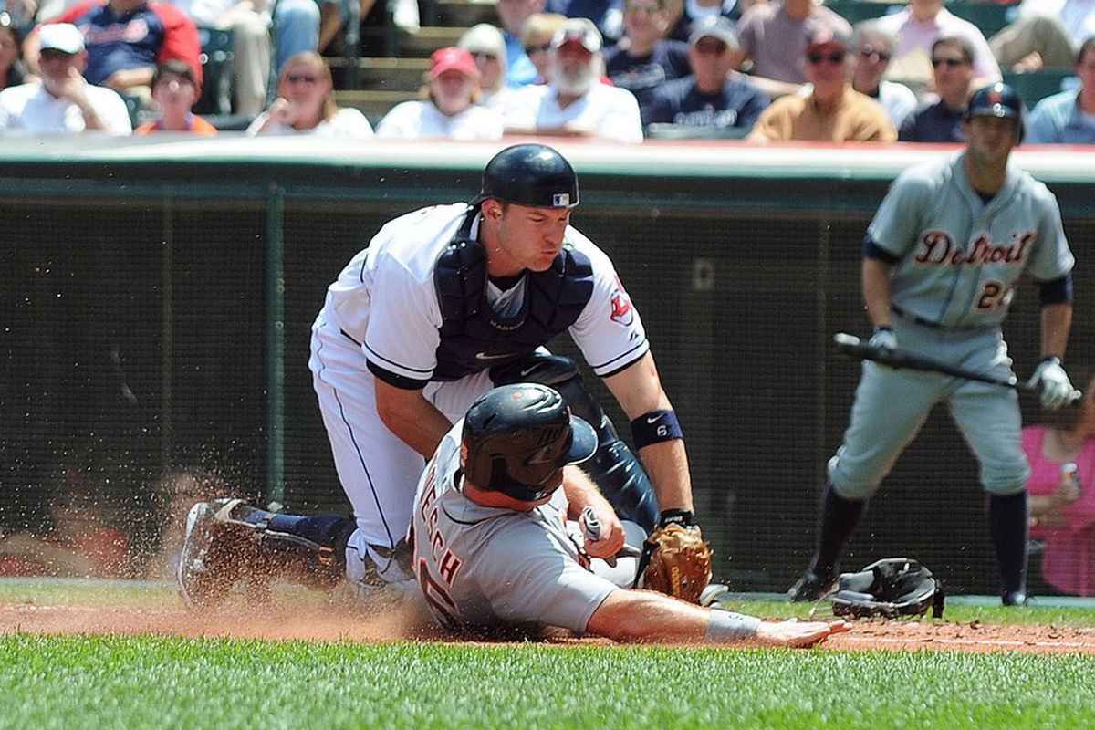 May 24, 2012; Cleveland, OH, USA: Cleveland Indians catcher Lou Marson (top) tags out Detroit Tigers right fielder Brennan Boesch (26) at home plate during the third inning in the game at Progressive Field.  Mandatory Credit: Eric P. Mull-USPRESSWIRE
