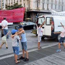 Young boys fly paper airplanes made from pamphlets at a rally for the rights of refugees in Athens, Greece, in July 2016.