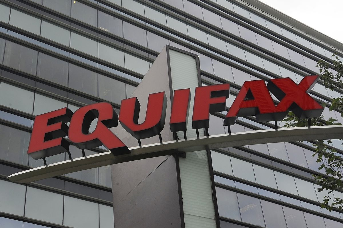 FILE - This July 21, 2012, file photo shows signage at the corporate headquarters of Equifax Inc. in Atlanta. The deadline to seek cash payments and claim free services as part of Equifax's $700 million settlement over a massive data breach is Wednesday, Jan. 22, 2020.