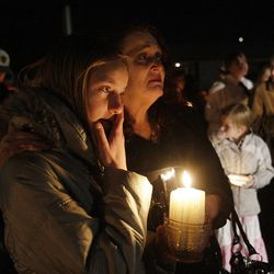 Auburn Henderson along with Powell family friends and well wishers hold a candlelight vigil in Salt Lake County  Sunday, Feb. 5, 2012. Josh Powell and his two sons were killed in an explosion in Washington.