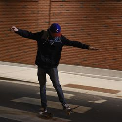 9:40 p.m. The younger ballhawks work on their skateboard moves -