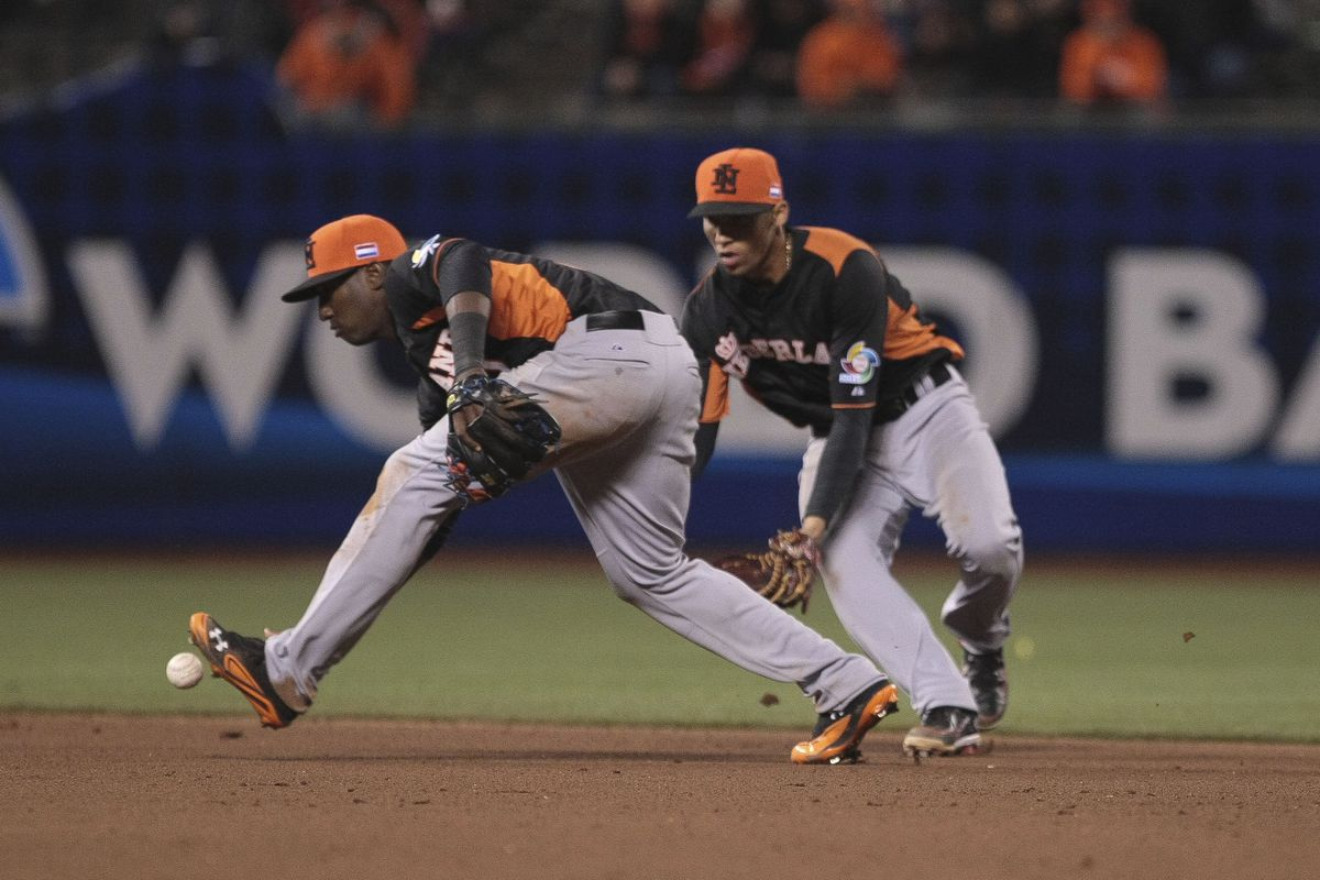Even without Jurickson Profar (left) or Andrelton Simmons (right), the Netherlands won the 2014 European Baseball Championship.