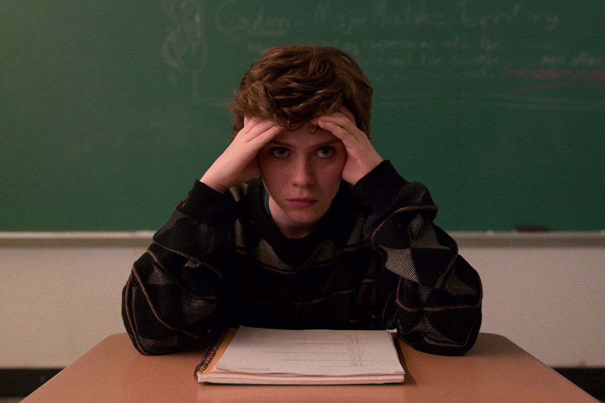 Syd (Sophia Lillis) looking frustrated in class, sitting at a desk in I Am Not Okay With This