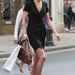 Spotted on April 20th, 2011, shopping on Kings Road in London while wearing a black Issa dress.