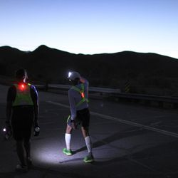 Ben Gaetos (R) of Los Angeles, California, the first person of Philippines nationality to run the event, begins the final ascent, up Whitney Portal Road, to the finish of the AdventurCORPS Badwater 135