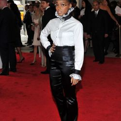 Janelle Monae in Chanel. People on Twitter seem to think her pants are unflattering, but we can't get past the top hat.