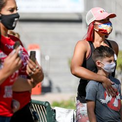 Stacy Bernal and her son, Eli, 8, attend a rally outside the Ogden Municipal Building in Ogden on Saturday, Sept. 12, 2020. People gathered to protest and call attention to the shooting of Linden Cameron, a 13-year-old with Asperger's syndrome who was shot by police in Salt Lake City.