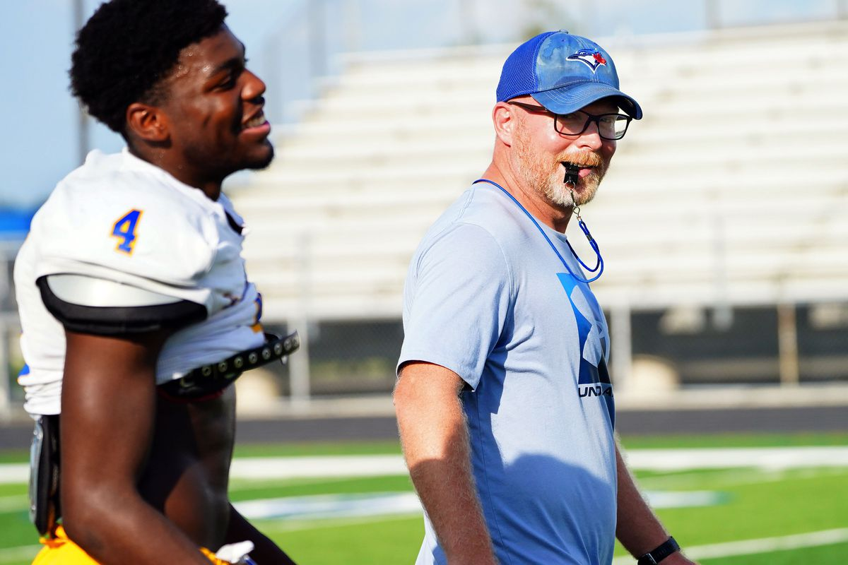 Sandburg football coach Troy McAllister shares a laugh at practice in Orland Park, Tuesday, August 24, 2021.