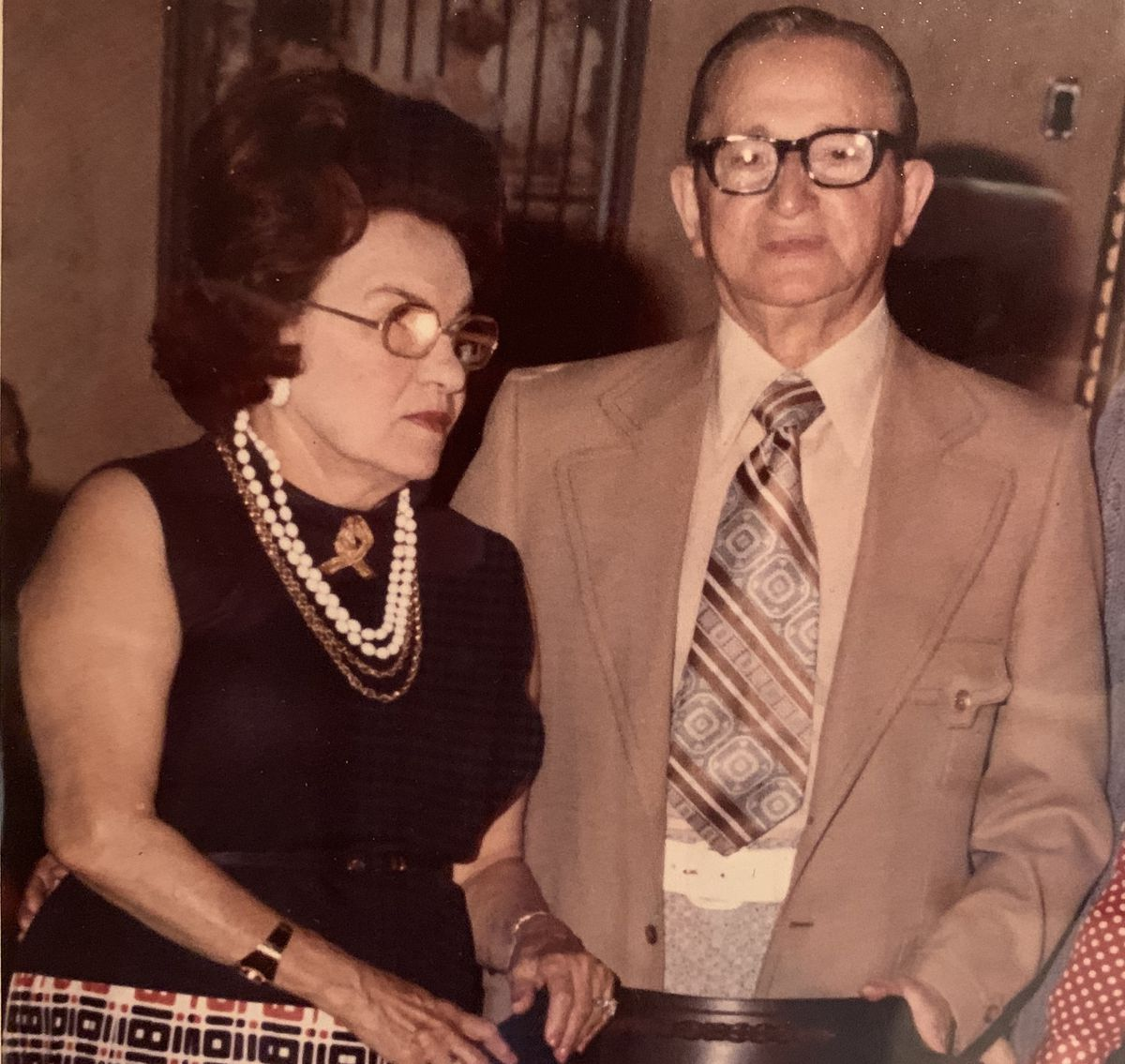 An old photograph of a couple in 1970s-era clothes.