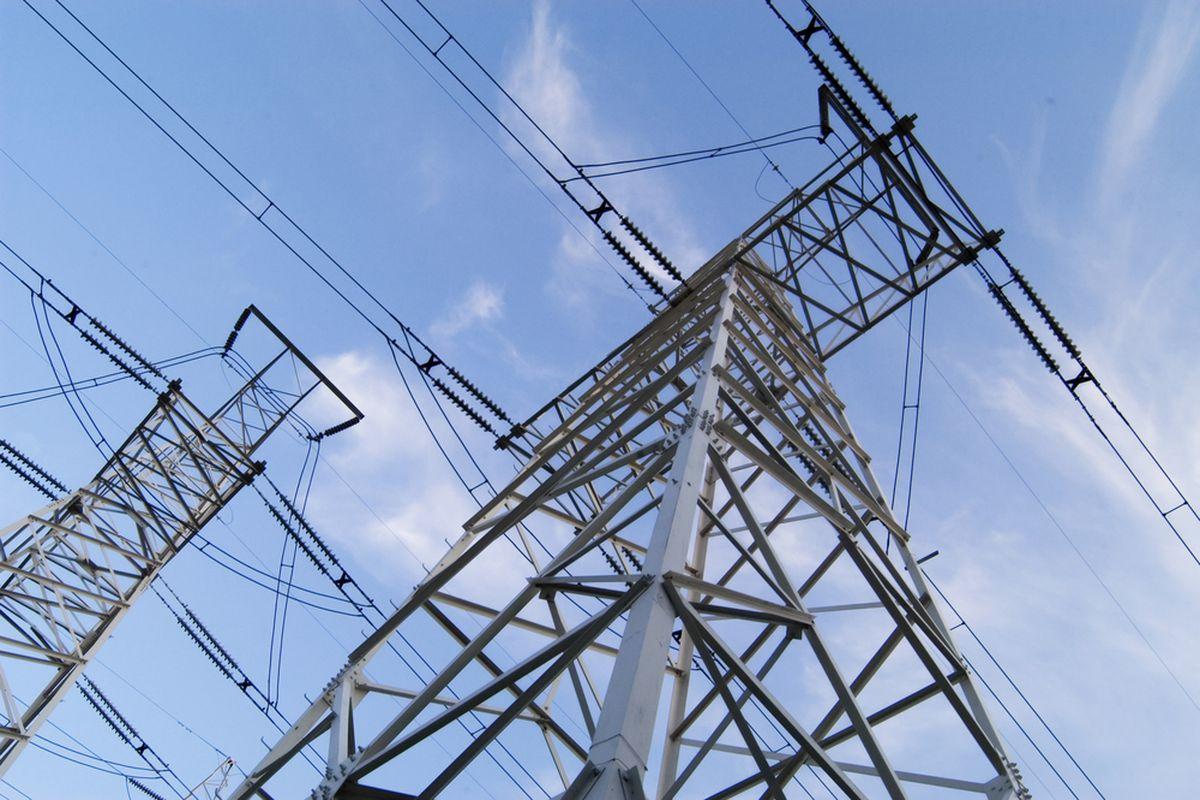 Power lines against a blue sky.