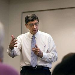 """Clayton Christensen speaks at a DMC meeting at the Triad Center in Salt Lake City on October 29, 2010. He is the author of a new book titled """"The Power of Everyday Missionaries."""""""