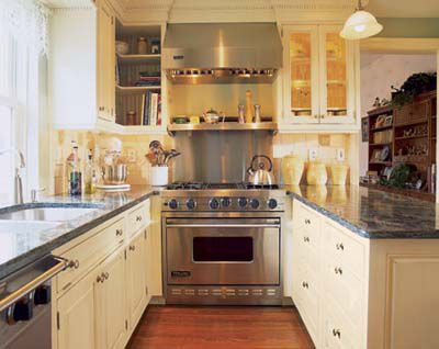 U-Shaped galley kitchen design with wine cubbies above the window.