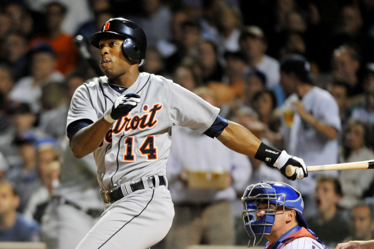 June 12, 2012; Chicago, IL, USA; Detroit Tigers center fielder Austin Jackson (14) hits a two run RBI single against the Chicago Cubs during the seventh inning at Wrigley Field.  Mandatory Credit: Rob Grabowski-US PRESSWIRE