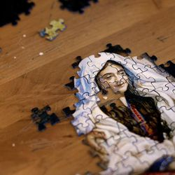 Joe Ortega works on a Nativity scene jigsaw puzzle in his room at Grace Mary Manor in South Salt Lake on Friday, Dec. 9, 2016. Ortega was living on the streets for 20 years until Ed Snoddy convinced him to get into housing. Ortega enjoys working on puzzles, reading, and cooking beans and rice in his room.