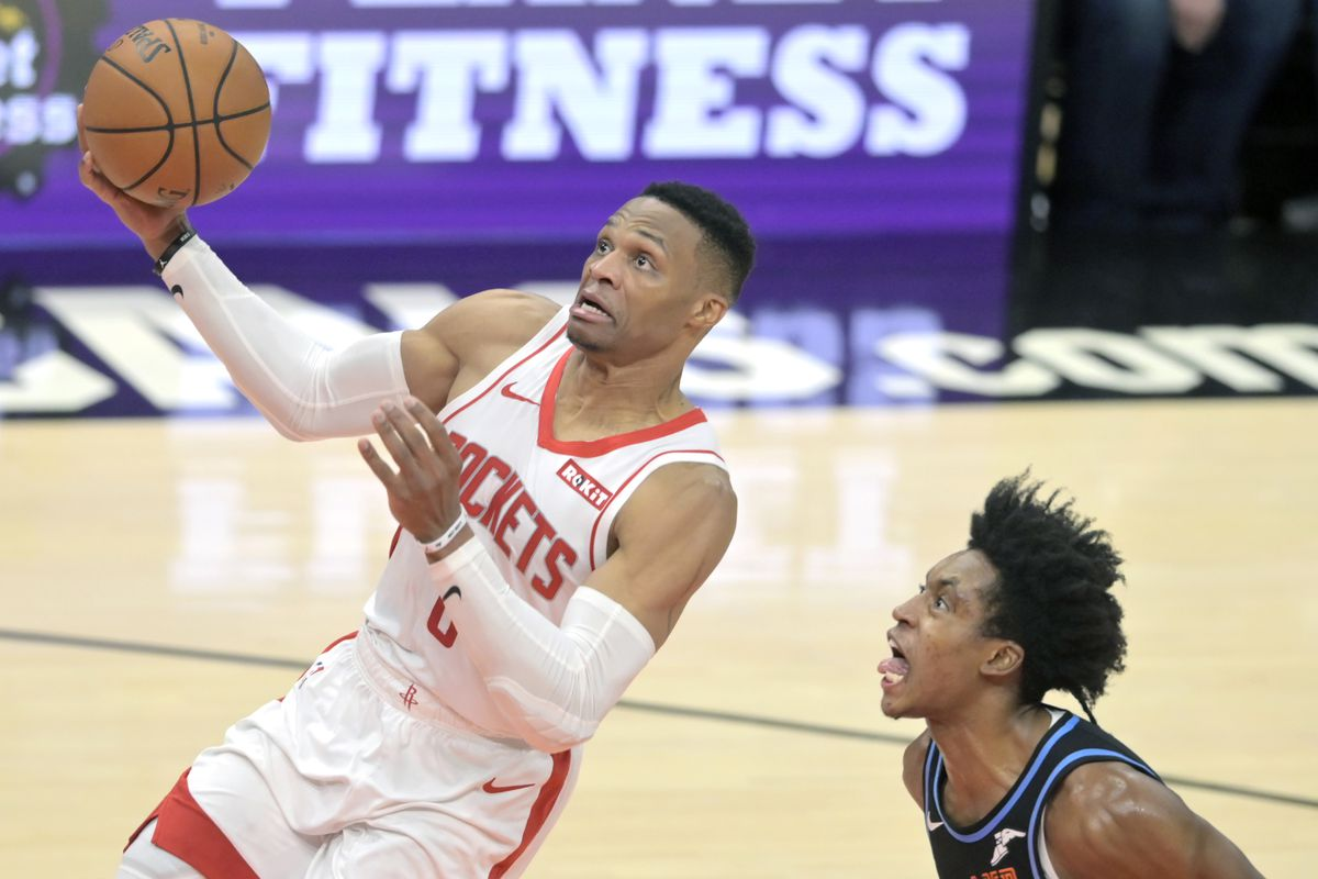 Houston Rockets guard Russell Westbrook drives to the basket against Cleveland Cavaliers guard Collin Sexton in the third quarter at Rocket Mortgage FieldHouse