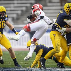 Utah Utes running back Zack Moss (2) is upended and turned around in the air at the Zaxby's Heart of Dallas Bowl between the Utah Utes and the West Virginia Mountaineers in Dallas Texas on Tuesday, Dec. 26, 2017.
