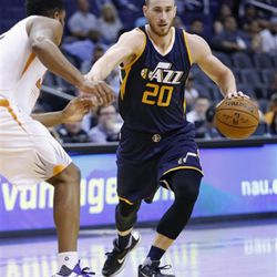 Utah Jazz's Gordon Hayward (20) dribbles past Phoenix Suns' Alan Williams, left, during the first half of an NBA preseason basketball game Wednesday, Oct. 5, 2016, in Phoenix.  The Jazz defeated the Suns 104-99. (AP Photo/Ross D. Franklin)