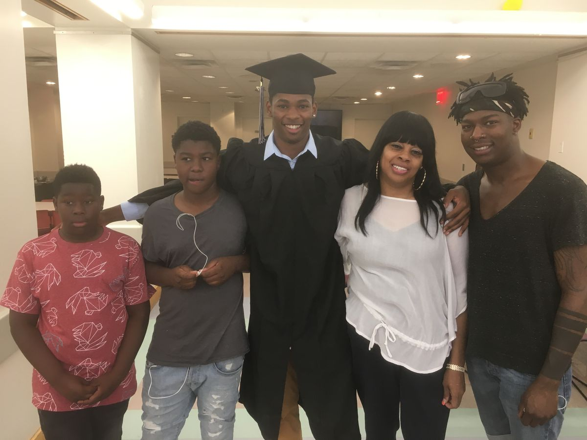 Jahrell Thomas with his mother and siblings immediately before graduation