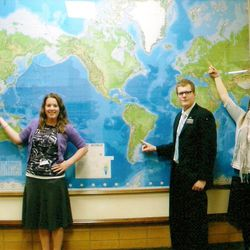 Sister Haley Pinkston, left, Elder Patrick Pinkston and Sister Heidi Pinkston point to the world map at the Missionary Training Center in Provo. Haley was called to Singapore. Patrick was called to Argentina. And Heidi was called Russia.