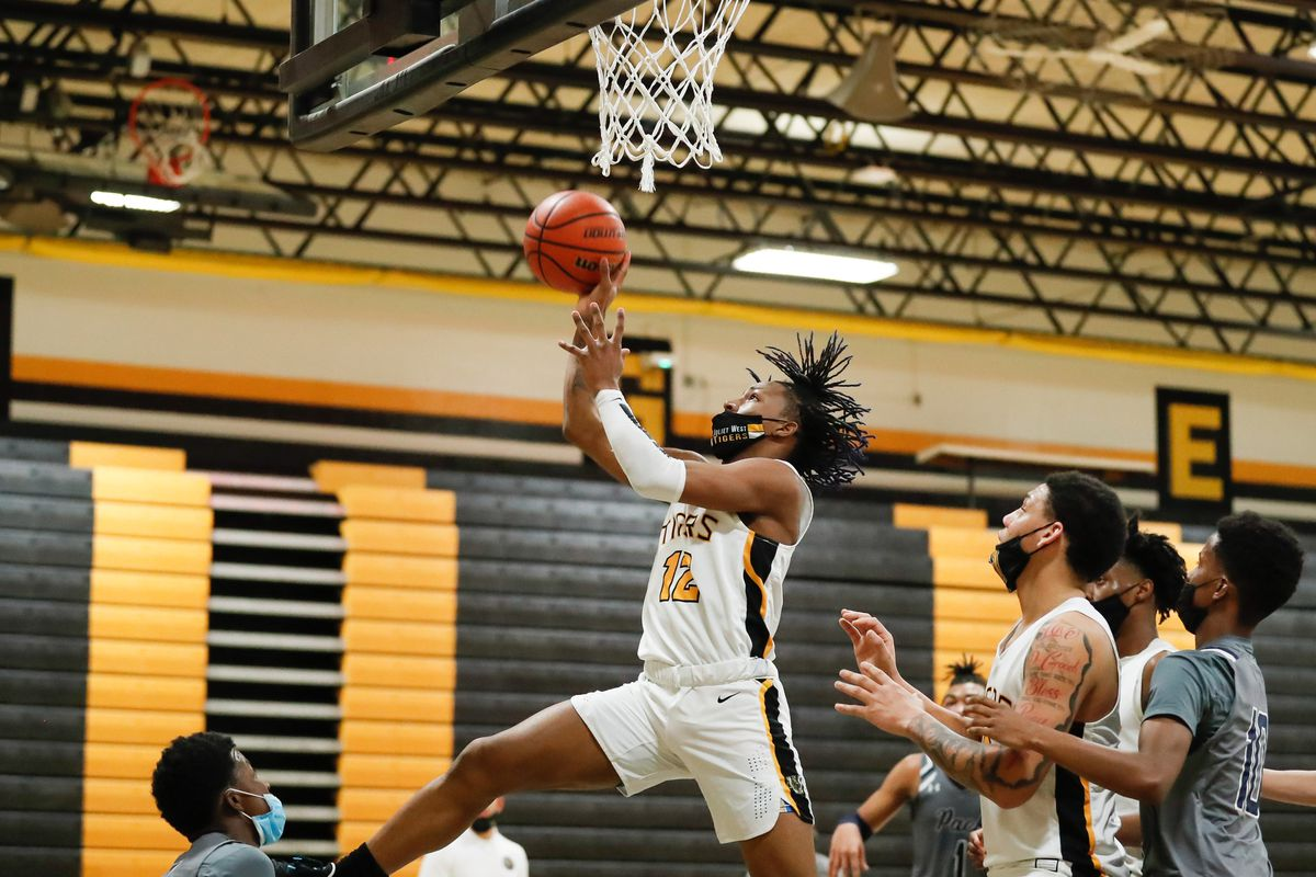 Joliet West's Terrance Moncrief (12) shoots the ball over Oswego East.