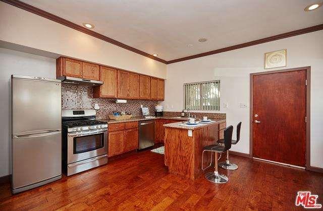 View of kitchen and front door