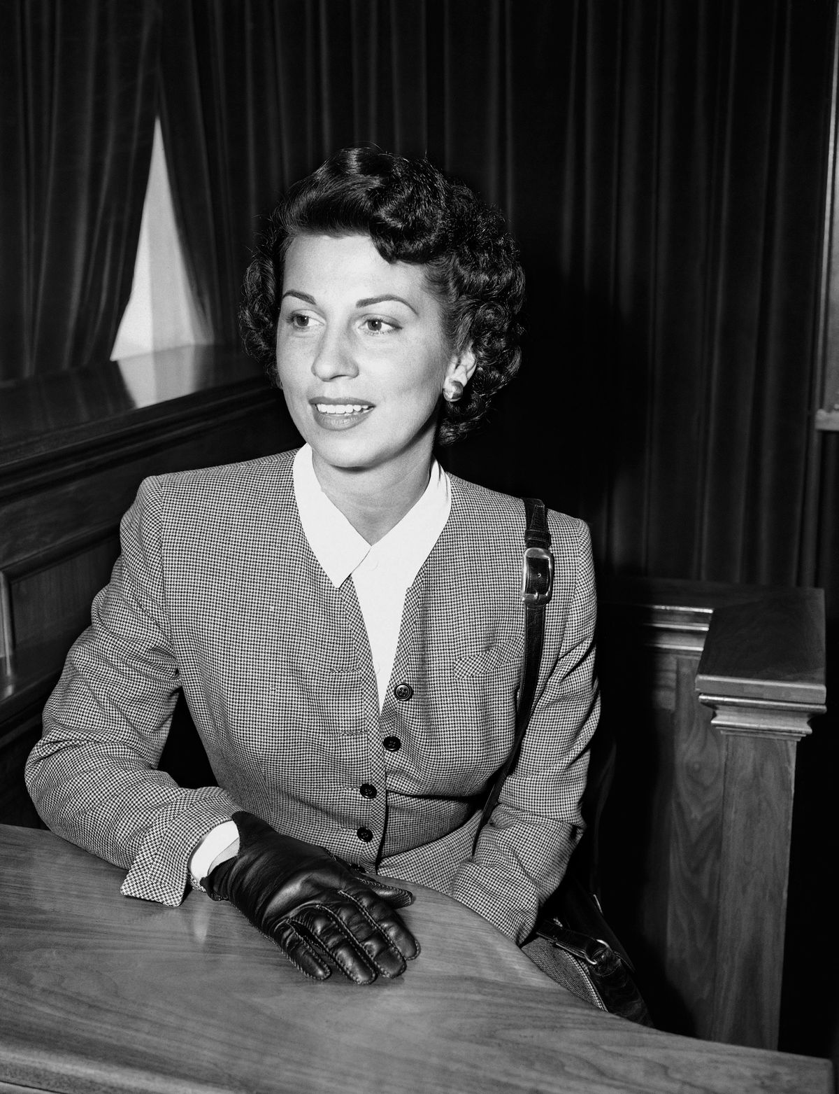 In this Sept. 28, 1950 file photo, Nancy Sinatra Sr. takes the witness stand in Superior Court in Santa Monica, Calif., where she was granted a decree of separate maintenance from singer Frank Sinatra.   AP Photo/Harold Filan, File