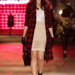 This grown-up-schoolgirl look includes a red-and-black plaid trench coat with a white tank, a nude, high-waisted skirt, and black ankle booties from Kristin Cavallari by Chinese Laundry. It's accessorized with a black satchel, black gloves, a floppy red h