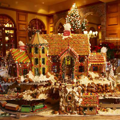 Fancy gingerbread house set in the woodlands.