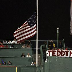 The flag at Fenway Park in Boston flies at half staff during a baseball game between the Boston Red Sox and the Toronto Blue Jays in honor of Senator Edward Kennedy.