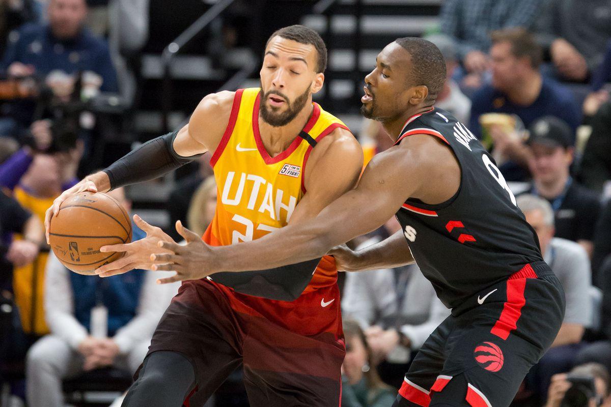 Toronto Raptors center Serge Ibaka defends against Utah Jazz center Rudy Gobert during the first quarter at Vivint Smart Home Arena.