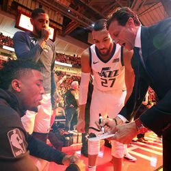 Utah Jazz guard Donovan Mitchell (45), Utah Jazz forward Royce O'Neale (23), Utah Jazz center Rudy Gobert (27) and Utah Jazz head coach Quin Snyder talk before the Jazz play the Houston Rockets in Game 5 of the NBA playoffs at the Toyota Center in Houston on Tuesday, May 8, 2018.