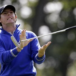 Europe's Rory McIlroy reacts to a putt on the seventh hole during a practice round at the Ryder Cup PGA golf tournament Wednesday, Sept. 26, 2012, at the Medinah Country Club in Medinah, Ill.
