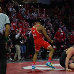 Nebraska's Chad Red Jr. celebrates after pinning Michigan's Cole Mattin in their 141-pound match Friday night at the Devaney Sports Center.