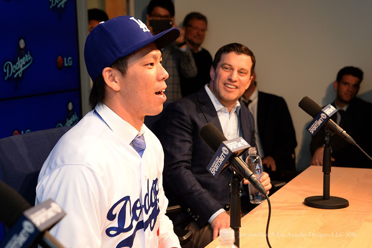 Kenta Maeda addresses reporters, with Andrew Friedman looking on.