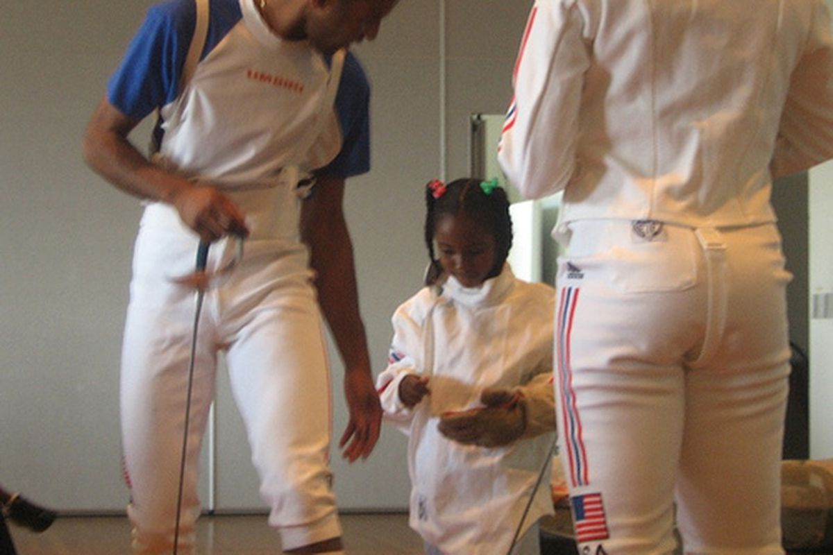 Keeth Smart, teaching a youngster the finer points of fencing.