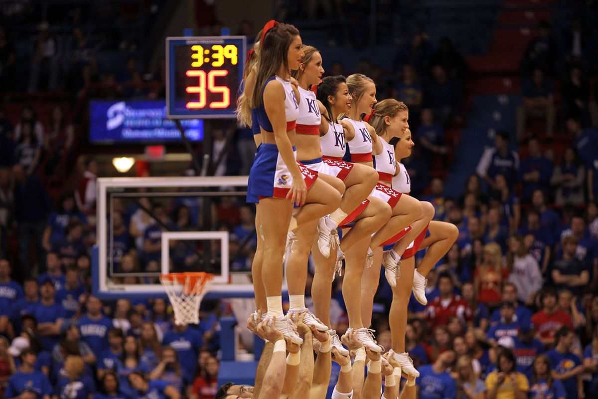 LAWRENCE, KS - NOVEMBER 30:  Kansas Jayhawk cheerleaders perform during a timeout in the game against the Florida Atlantic Owls on November 30, 2011 at Allen Fieldhouse in Lawrence, Kansas.  (Photo by Jamie Squire/Getty Images)