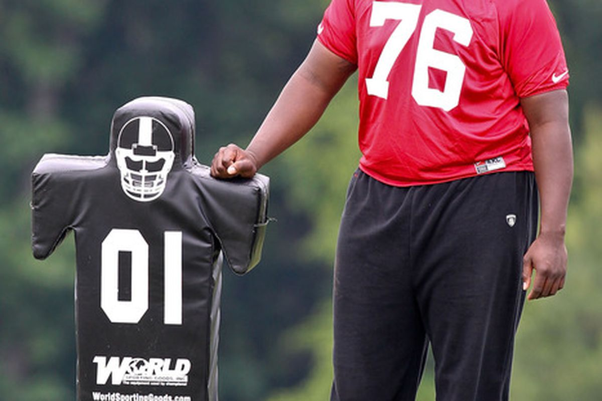 FLOWERY BRANCH, GA - MAY 12: Lamar Holmes #76 of the Atlanta Falcons watches practice during the rookie minicamp at the Atlanta Falcons Training Facility on May 12, 2012 in Flowery Branch, Georgia. (Photo by Daniel Shirey/Getty Images)
