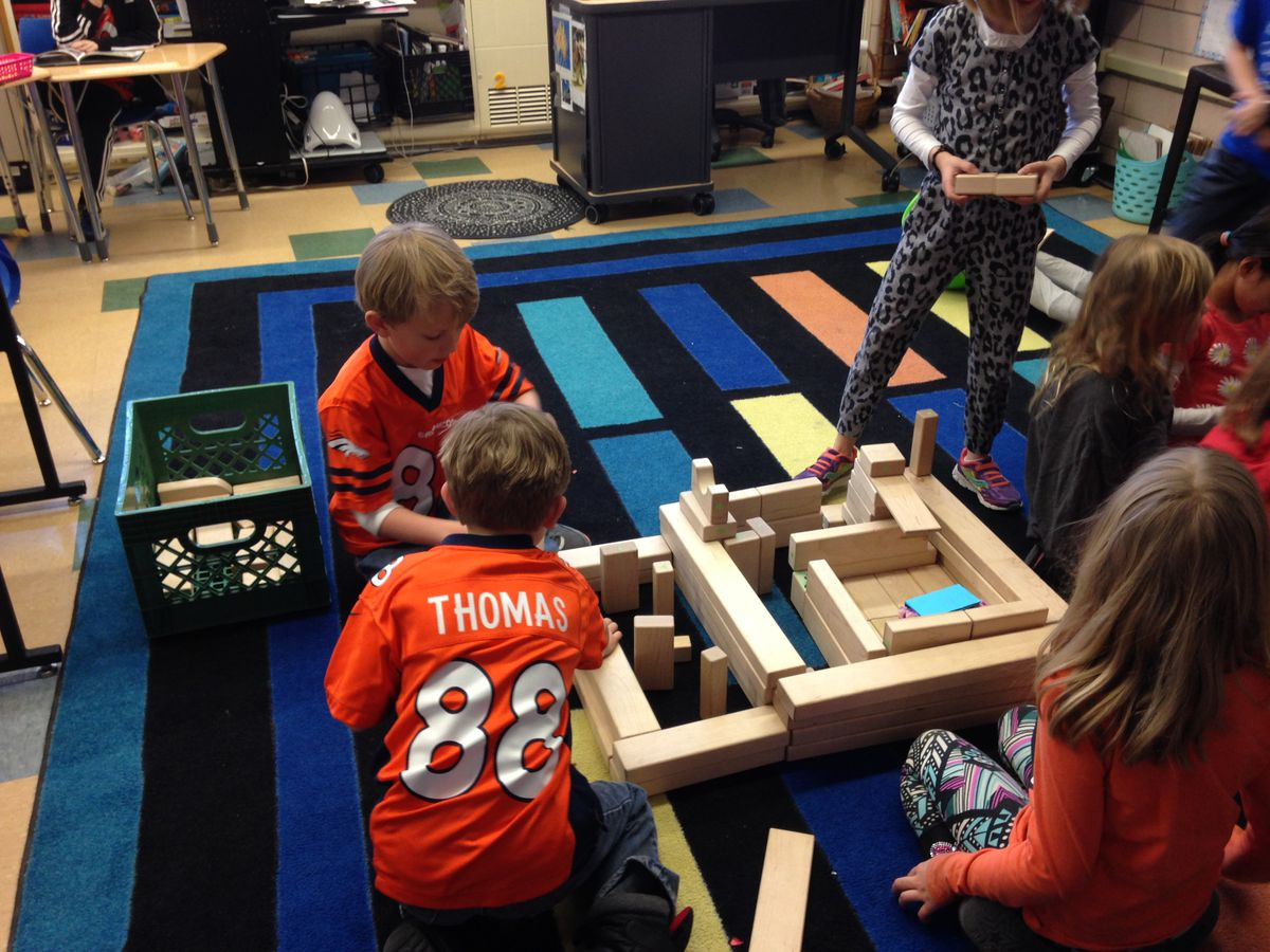 Students at Creativity Challenge Community build with blocks.