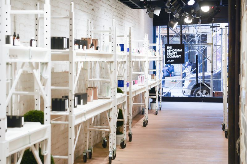 White wire racks hold skincare in Deciem's new store.