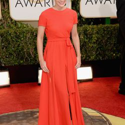 More red on the carpet via Emma Watson in Dior.