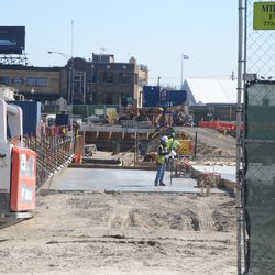 3:40 p.m. View  through an open work gate into the triangle lot -